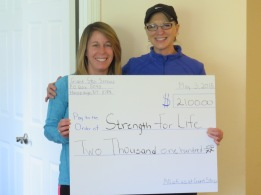 "Lauri Alpern presenting Jacqui Errico of ""Strength For Life"" a check from Giant Step Services 5/3/15"